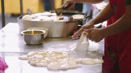 market vendor : Vendor making roti canai at bazaar ramadan