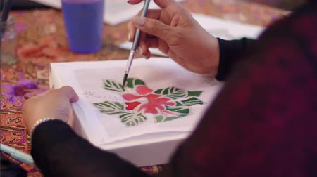hibiscus : Slow motion of hibiscus batik painting Stock Footage