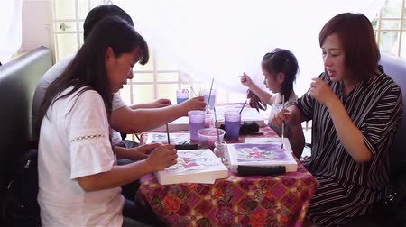 participants : Panning shot of family batik painting at Emilia Batik House Stock Footage