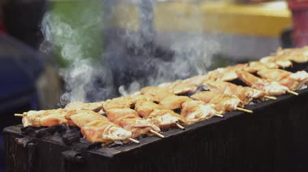 ramadan bazaar : Grilling chickens on barbecue pit at bazaar Ramadan