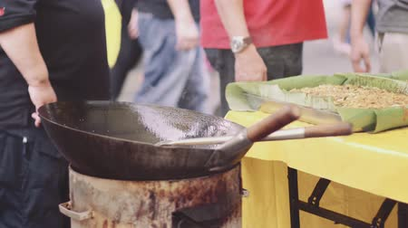 ramadan bazaar : Stir frying kway teow at bazaar Ramadan Stock Footage