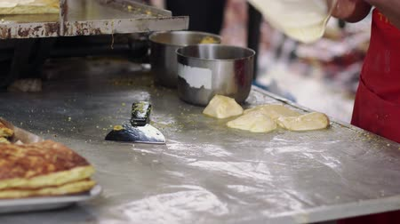 pan fried : Vendor making murtabak at bazaar Ramadan Stock Footage