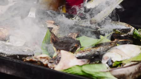ramadan bazaar : Grilling fish on a griddle at bazaar Ramadan Stock Footage