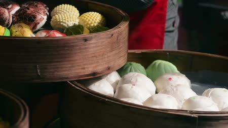 bamboo steamer : Delicious assorted bao in bamboo steamer at bazaar Ramadan