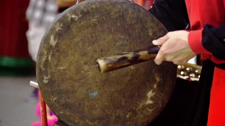 gong : Hand gong player hitting the music instrument