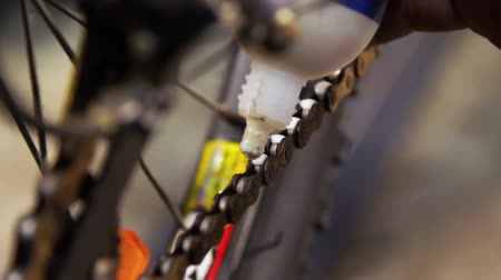 repairer : Closeup of lubricating bicycle chain