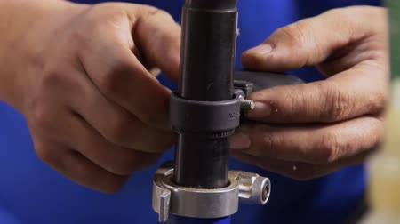 repairer : Closeup on fixing rear light on bicycle seatpost Stock Footage