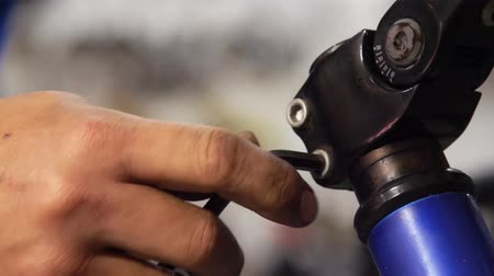 repairer : Closeup on fixing bicycle stem