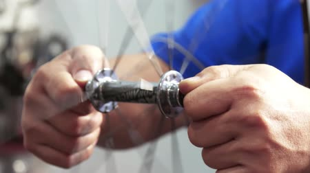 repairer : Closeup on bicycle wheel maintenance