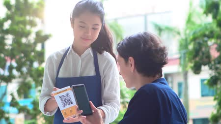 qr : Person paying with QR phone scan Stock Footage