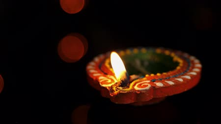 祈り : Clay diya lamps lit on diwali celebration 動画素材