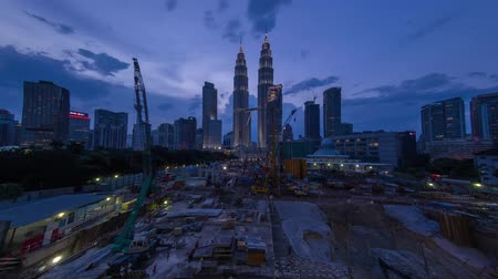 kuala lumpur skyline : A day to night time lapse of Petronas Twin Towers with pan camera movement. Stock Footage