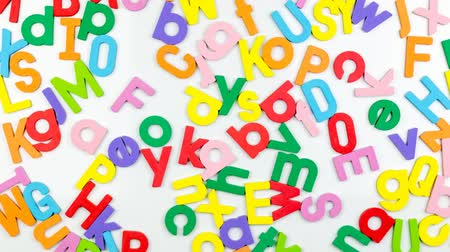 hűtőgép : Alphabet magnets being shuffled around, stop motion Stock mozgókép