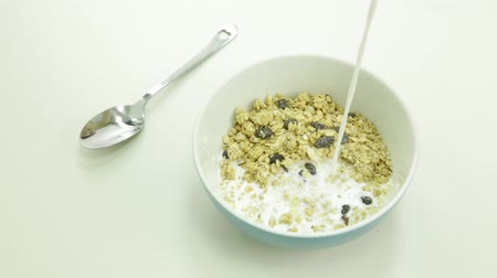 otruby : Milk being poured into a bowl of cereal, too much milk