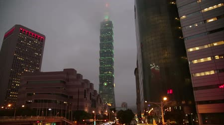 pénzügyi negyed : TAIPEI, TAIWAN - MARCH 19, 2015:  Night footage of Xinyi Financial District in Taipei, including Taipei 101 skyscraper. Taipei 101 ranked worlds tallest building from 2004 until 2010.
