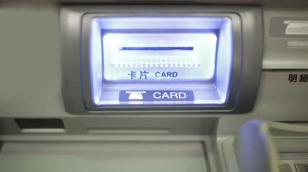 převod : Inserting ATM card in slot -shot from front
