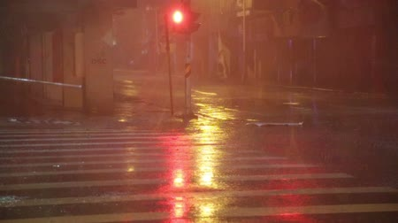 ulewa : Heavy rain on street corner during typhoon blowing debri slow motion22