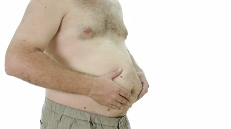 tłuszcz : Obese man squeezing fat stomach 45 degree angle Wideo