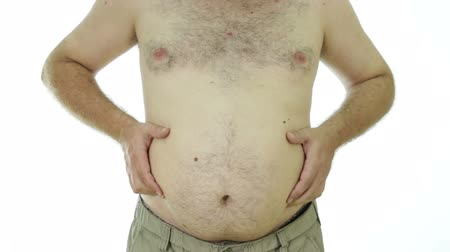 tłuszcz : Obese man squeezing stomach love handles