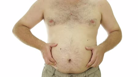 şişman : Obese man squeezing love handles on stomach Stok Video