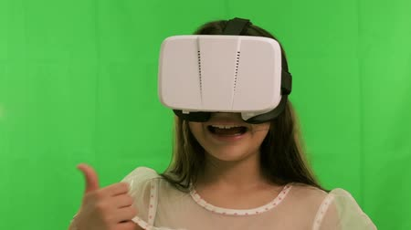 girl wearing VR headset on green screen
