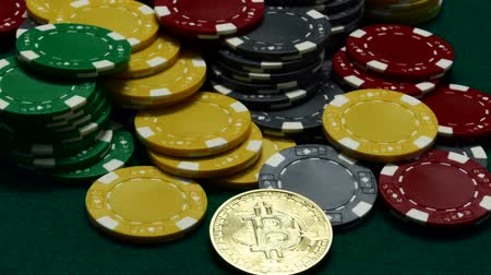 Bitcoin and casino chips on gambling table