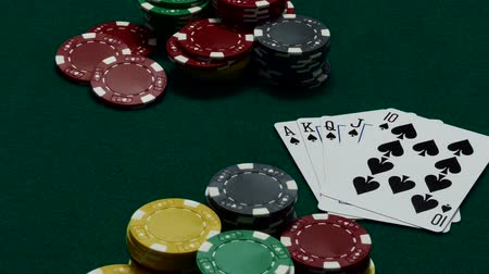 Royal flush and casino chips on gambling table