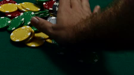 Betting all casino chips with winning hand Стоковые видеозаписи