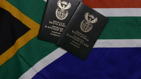 id : South African passports on flag Stock Footage