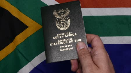 South African passports on flag Стоковые видеозаписи