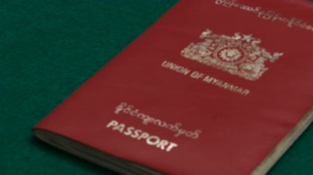 gümrük : Myanmar passport on table Stok Video