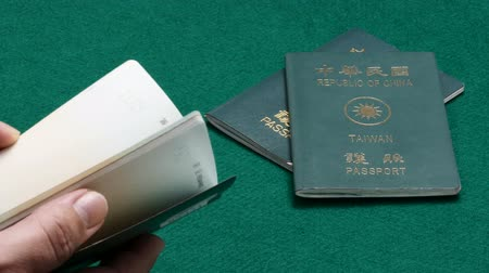 Taiwanese passports on green table