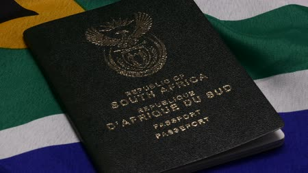 gümrük : South African passports on flag Stok Video