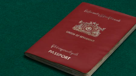 Burmese passport on table