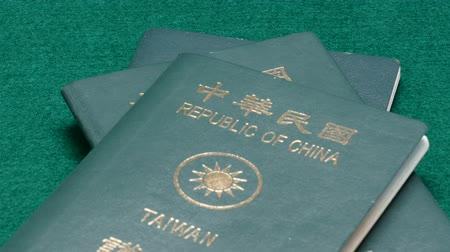 zvyk : Taiwanese passports on green table