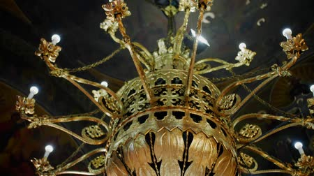 kelet : Interior of a traditional Orthodox Church - Golden chandelier Stock mozgókép