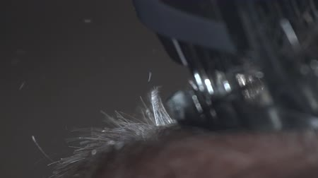 Woman hairdresser shaves a head of bald man. Close-up: Hairdresser makes hairstyle bald man. Stok Video