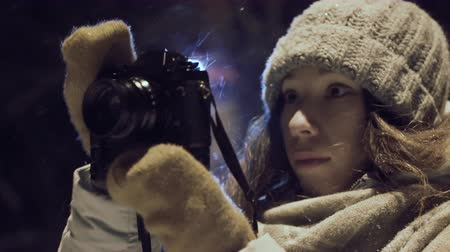 girl photographer shooting outdoors on snow winter night ligh park. Stock Footage