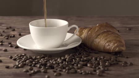 settings : Coffee break times. Aroma of hot black americano coffee with croissants bakery a good refreshing afternoon. World Food and drink concept.