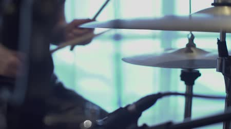 Rock drummer in silhouette performing on stage Stok Video