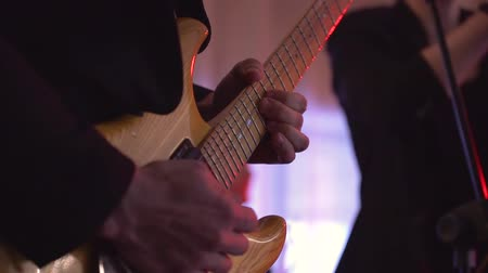 Man lead guitarist playing electrical guitar on concert stage slow motion. Stock Footage