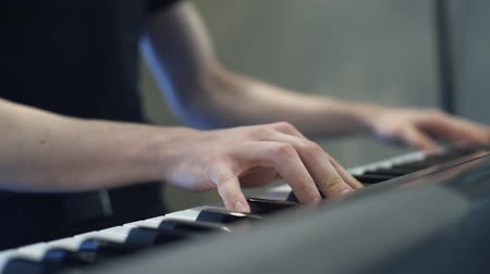 to play the piano, hands playing the piano.
