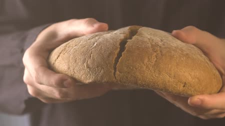 Baker hands breaking homemade bread. Close up view. Stock Footage