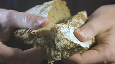 Baker hands breaking homemade bread. Close up view. Stok Video
