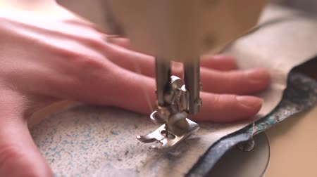 Seamstress sewing on the sewing machine