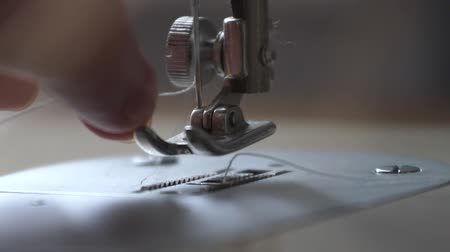 girl inserts thread a needle. close up. Stok Video