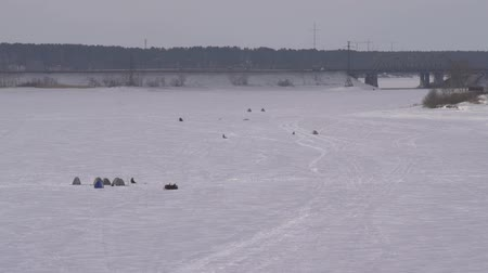 winter day : Aerial, group fishermen on the frozen lake in winter.