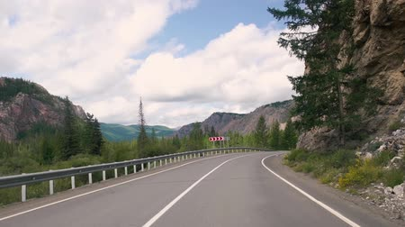 foothills : Driving on a summer mountain road.