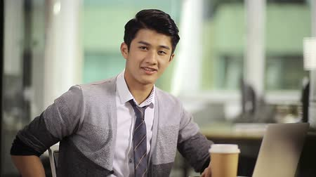 casual wear businessman : successful young asian business executive looking at camera smiling. Stock Footage
