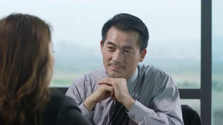 doubt : asian business man and woman talking in office. Stock Footage